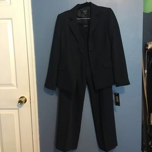 Woman's Kasper Navy Blue pinstriped pant suit.